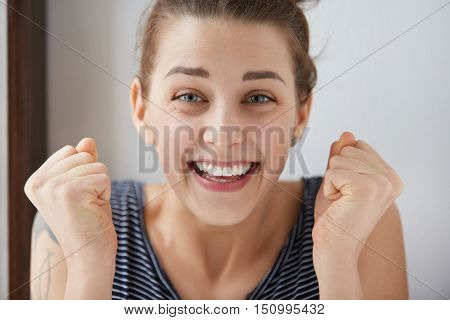Happy Young Caucasian Woman Bursting With Joy And Pleasure. Beautiful Girl With Blue Eyes Doubles He