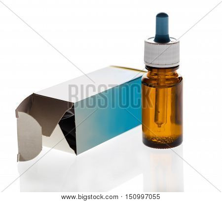 medicament in a glass vial on white background