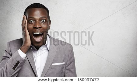 I Can't Believe This! Portrait Of Good-looking African Entrepreneur In Formal Wear Shouting With Sur