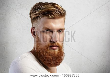 Sideways Portrait Of Natural Blond Caucasian Man On White Background. Bearded Hipster With Clean Sha
