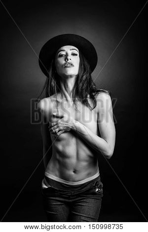Topless Woman Wearing Blue Jeans, Panties And Hat