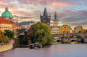 Famous Prague Landmarks - towers and bridge at sundown time with beautiful sky, Prague, Czech, Europ poster