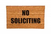 image of soliciting  - A no soliciting doormat isolated on a white background - JPG