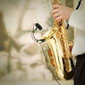 image of sax  - playing on sax - JPG