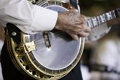 pic of san fernando valley  - Black and white image of a banjo being played by an older gentleman - JPG