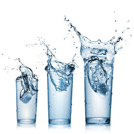 stock photo of alcoholic drinks  - water splash in glasses isolated on white - JPG