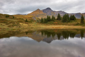 image of mountain-range  - Small fine and smooth lake in the Swiss Alpes reflecting mountains - JPG