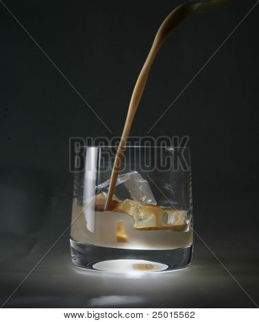 A glass with ice cubes and Irish cream