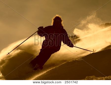Skier In Cloude Of Powder