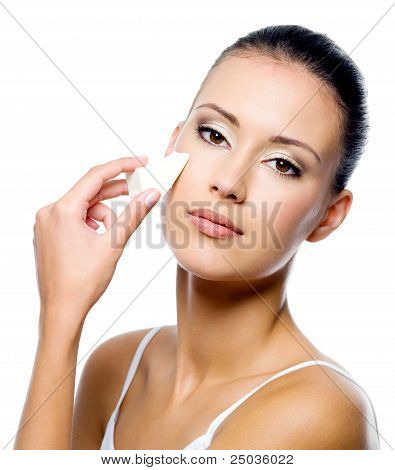 Woman Applying Foundation On Face