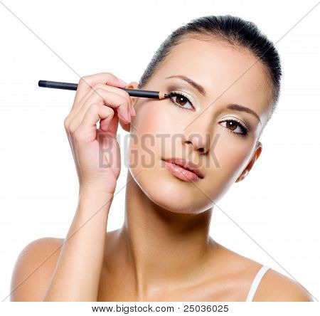 Woman Applying Eyeliner On Eyelid With Pensil
