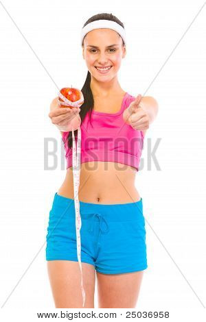 Smiling Fitness Female Holding Apple With Measuring Tape And Showing Thumbs Up