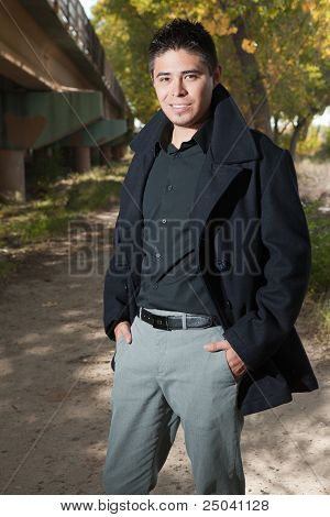 Handsome man outdoors in autumn