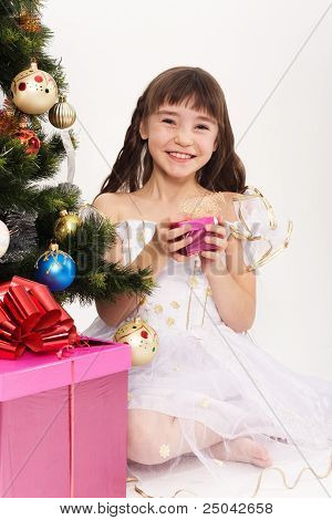 Little Laughing Girl Opening Christmas Present