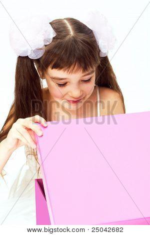 Little Smiling Girl Opening Christmas Present