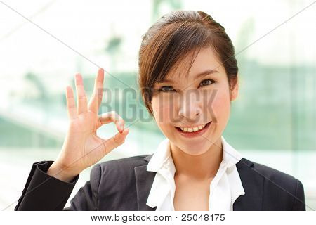 Bright portrait of business lady showing