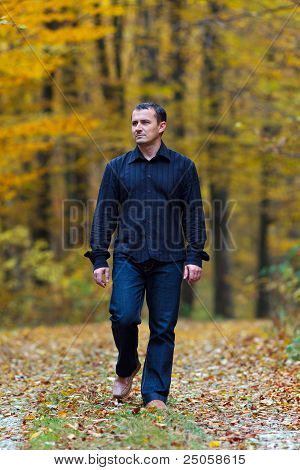 Man Walking Into The Forest