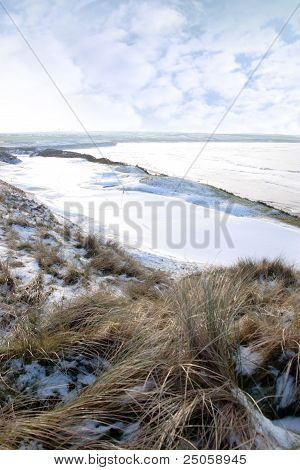 Atlantic Ocean Beside Snow Covered Golf Course With Yellow Flag