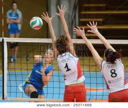 KAPOSVAR, HUNGARY - OCTOBER 21: Zsanett Pinter (L) in action at a Hungarian NB I. League volleyball game Kaposvar (blue) vs Godollo (white), October 21, 2011 in Kaposvar, Hungary.