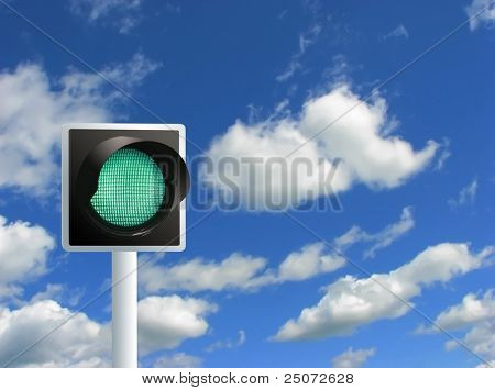 Green light on the blue sky background.