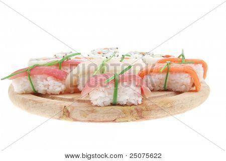 Maki Sushi and Nigiri - California Maki Roll made of fresh raw Salmon, Cream Cheese and Avocado inside with Nigiri Sushi topped with Salmon Tuna and Eel. Isolated over white background