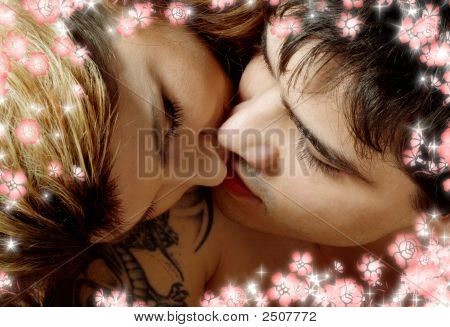 Kissing In Bed With Flowers