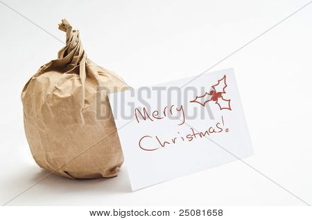 Christmas Apple In Brown Paper