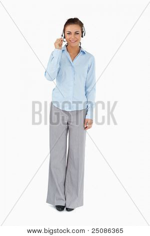 Businesswoman talking to caller through headset