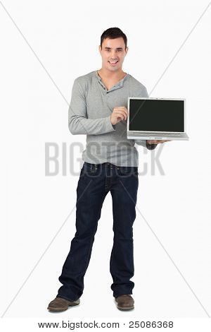Young male presenting his laptop against a white background
