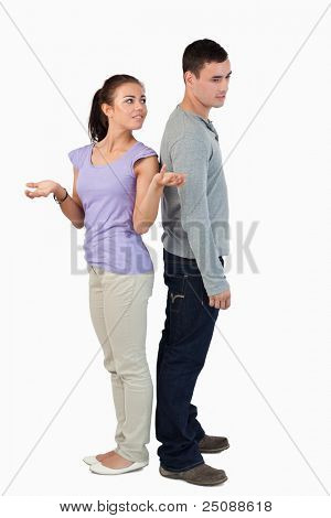 Young couple experiencing relationship problems against a white background