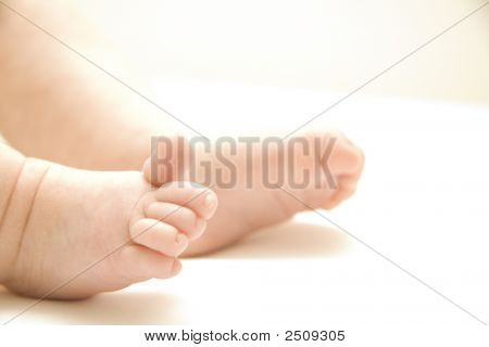 Baby feet of a 3 month old girl with a