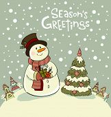 stock photo of beside  - Snowman with gifts beside christmas tree - JPG