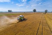 Drone View Of Harvester Combine Working On Field. poster