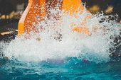 Splashings From Girl Gone Down On The Rubber Ring By The Orange Slide In The Aqua Park. Summer Vacat poster
