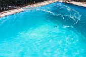 Splashing Of Disinfectant In Outdoor Swimming Pool On Backyard Of Country House poster