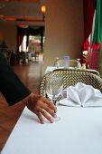pic of table manners  - waiter arange the restaurant table or table manner - JPG