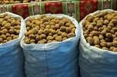 Sack Of Whole Fresh Walnuts With Hard Nutshells poster