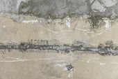 Rough Peeled Yellow Orange Gray Concrete Wall With Putty Patches Background poster