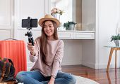 Asian Young Female Blogger Recording Vlog Video With Mobile Phone Live Streaming When Travel.online  poster