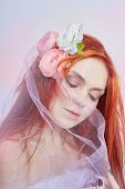 Redhead Girl In Light Airy Colored Dress Sits On The Floor White Background. Beautiful Flowers In Gi poster