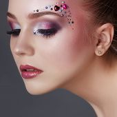 Art Makeup Over The Eyebrows Of Women Many Rhinestones Of Different Shapes, Beautiful Face Smooth Sk poster