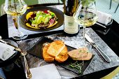 Tasty Foie Gras With Toasts And Glass Of White Wine At A Restaurant poster