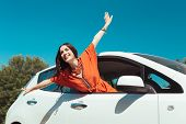 Feeling Free. Smiling Beautiful Woman Feeling Young And Free While Traveling In Car With Her Husband poster
