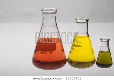 Erlenmeyer flasks with orange, yellow and greeen liquids