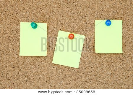 three yellow memo sticker on notice cork board