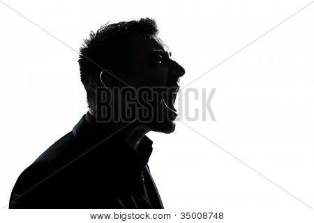 one caucasian man portrait silhouette profile screaming angry in studio isolated white background