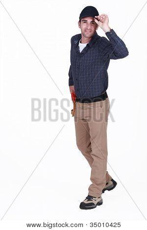 Man tipping cap