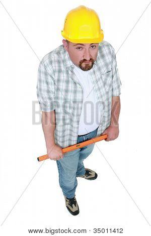 Tradesman holding a tool