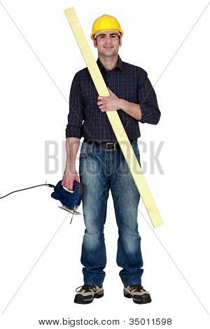 Carpenter using his electric drill