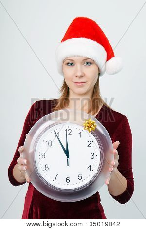 Young Attractive Girl With A Clock